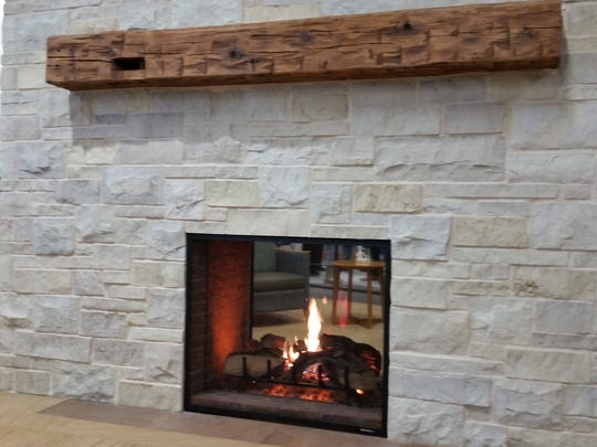 A double-side fireplace that separates the reception