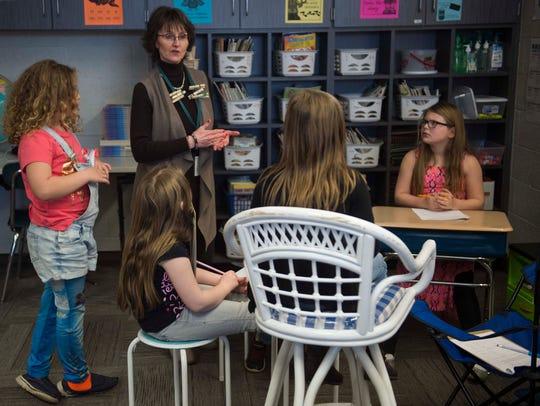 Gwen Fulk works with a small group of her second grade