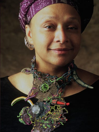 Joyce C. Scott wears some of her own beadwork in this