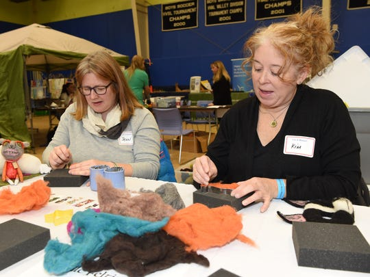 Jenni Glassford, left, a teddy bear and doll artist from LaGrange, and Kim Canez, right, a volunteer from Hyde Park, demonstrate how to do needle felting at the Poughkeepsie Mini Maker Faire, held Poughkeepsie Day School in the Town of Poughkeepsie.