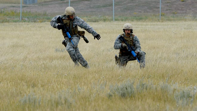 Candidates for the tactical response force practice securing a landing zone and loading and unloading from a helicopter during their tryout process on Sept. 20, 2016 at Malmstrom Air Force Base.