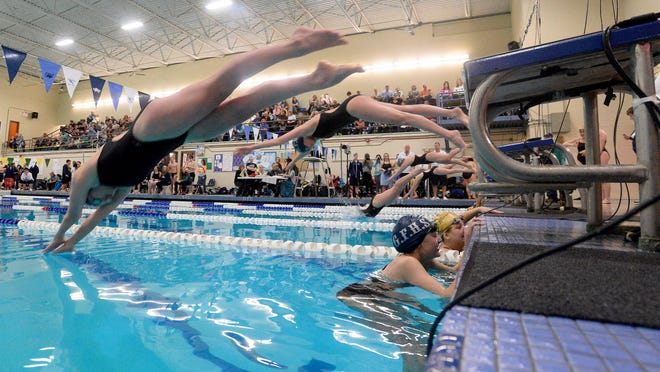 CMR and Great Falls High swimmers compete during the crosstown meet on Feb. 2.