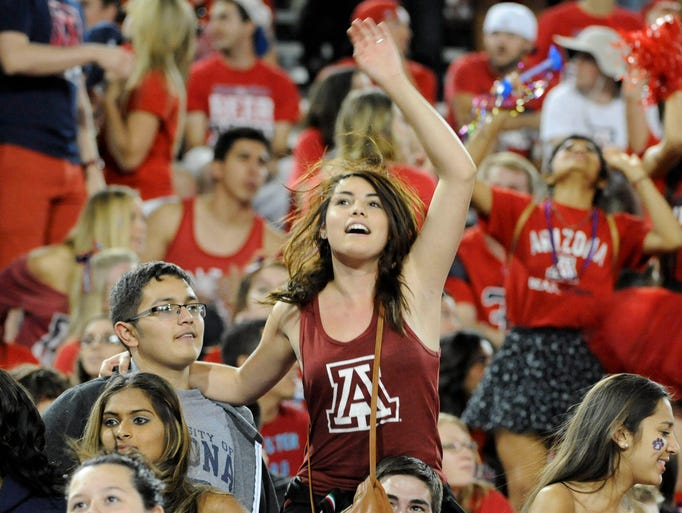 Arizona Wildcats fans dance in the student section