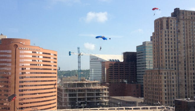 A group of parachuters landed on top of a Downtown parking garage Monday, but where they came from is a mystery.