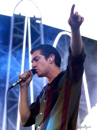 Alex Turner, of the Arctic Monkeys, performs during the Harrison College Summer Concert Series at the Farm Bureau Insurance Lawn at White River State Park in Indianapolis on Tuesday, June 24, 2014.