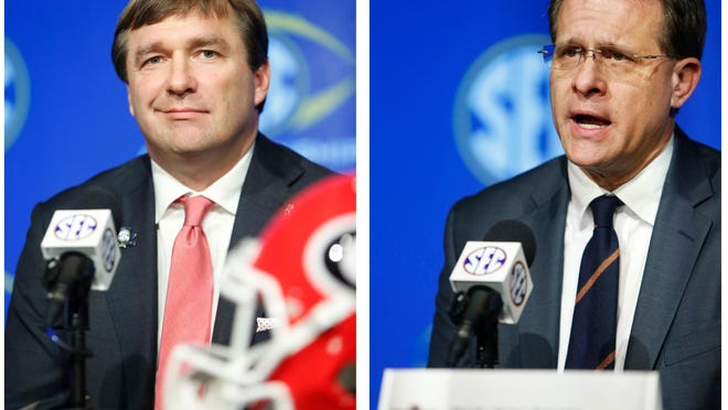 Georgia head coach Kirby Smart, right, and Auburn head coach Gus Malzahn speak with the media at the Mercedes-Benz Stadium in Atlanta, Ga., on Friday, Dec. 1, 2017.