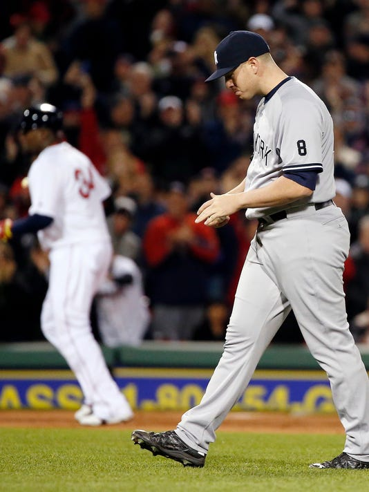 New York Yankees' Johnny Barbato walks back to the mound as Boston Red Sox's David Ortiz, left, rounds third base on a solo home run during the seventh inning of a baseball game in Boston, Saturday, April 30, 2016. (AP Photo/Michael Dwyer