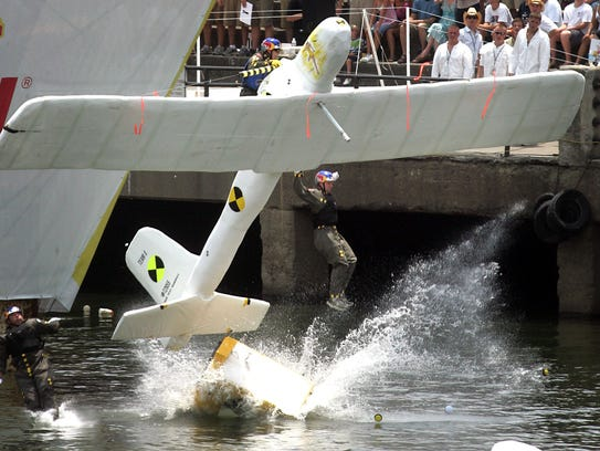 "Members of the ""Crash Test Dummies"" hit the water of"