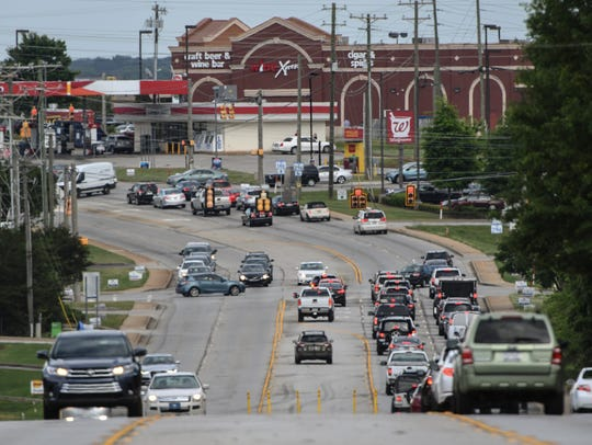 Cars drive through the Five Forks area on Woodruff
