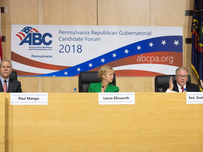 From the left, Paul Mango, Laura Ellsworth listen to