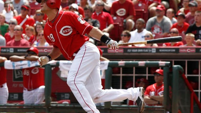 Cincinnati catcher Devin Mesoraco hits an RBI double off of Pittsburgh reliever Stolmy Pimentel in the fifth inning Sunday.