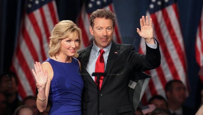 Sen. Rand Paul, right, waves to the crowd with his wife, Kelley, just before he announced that he will be seeking the White House in 2016 during a speech at the Galt House in Louisville.   April 2015