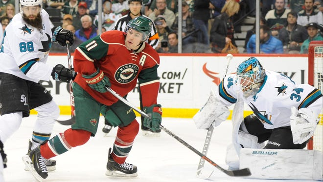 Wild forward Zach Parise looks for a pass as San Jose Sharks goalie James Reimer prepares for a shot during the second period at Xcel Energy Center.