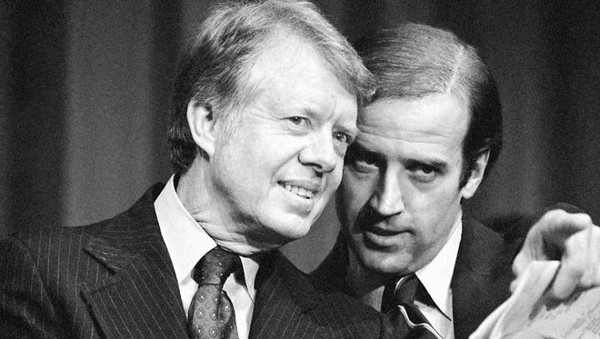 President Jimmy Carter listens to then-Sen. Joe Biden as they wait to speak at a fundraising reception at Padua Academy in Wilmington, on Feb. 20, 1978. Biden was elected to the Senate when he was 29.