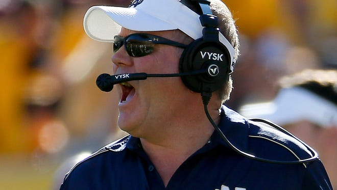 Notre Dame head coach Brian Kelly yells during the first half of an NCAA college football game against Arizona State, Saturday, Nov. 8, 2014, in Tempe, Ariz. (AP Photo/Matt York)