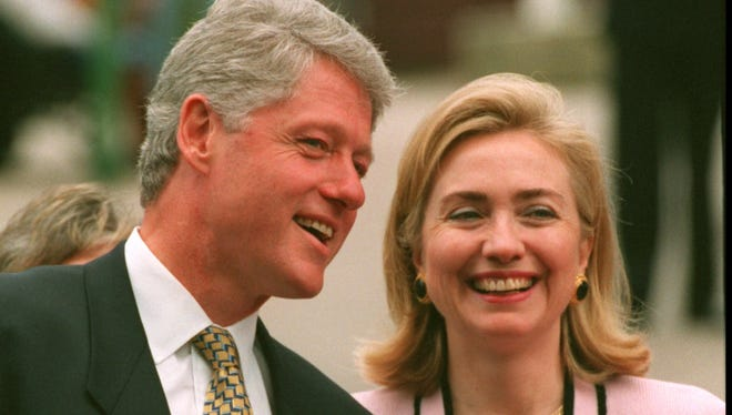 President Bill Clinton talks to first lady Hillary Rodham Clinton upon their arrival in Nova Scotia in June 1995.