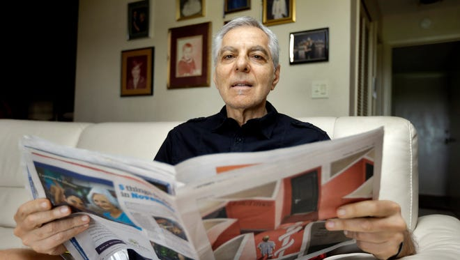 "In this Nov. 17, 2015, photo, Sal Natale looks over a Medicare brochure at his home in Seminole, Fla. Rising drug costs are starting to hit Medicare's popular prescription drug program, with many senior citizens looking at double digit premium increases next year. Natale, a retired dentist, said prescription premiums for him and his wife are going up about 30 percent next year, and he doesn't see a good alternative. ""I'm just going to grin and bear and hope it starts moderating,"" Natale said."