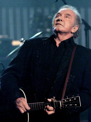 Johnny Cash performs at an all-star tribute concert in New York City in 1999.