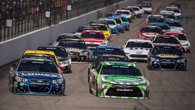 Jimmie Johnson and driver Kyle Busch lead the start of the New Hampshire 301 at the New Hampshire Motor Speedway.