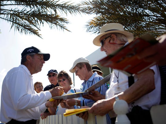 Hall of fame golfer Gary Player signs autographs after finishing the 18th hole during the final round of the ACE Group Classic golf tournament at the Quarry in North Naples on Feb. 20, 2011.