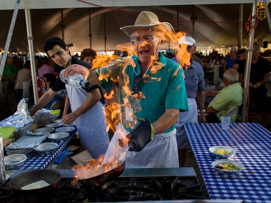 David Albers/Staff - Seasonal Naples resident Bill Mandros, of Parsippany, N.J., cooks Saganaki, or flaming cheese, at the annual St. Katherine Greek Fest at St. Katherine Greek Orthodox Church on Friday, Feb. 22, 2013, in Naples. The annual celebration of Greek culture continues through Sunday.