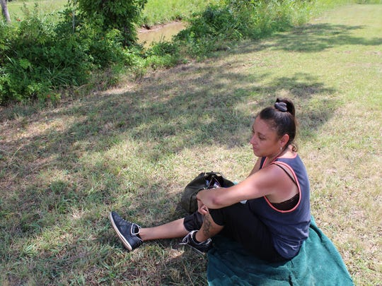 There were few people at Kirby Park on Wednesday afternoon. Three were in their vehicles while Alice Santos enjoyed the solitude near Cedar Creek. Santos said a woman had been in the park earlier with her dogs. Santos said she lives nearby.
