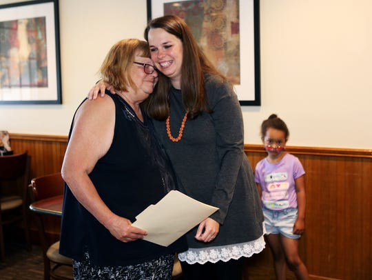 May 9, 2018 - Gail Pigue, left, is hugged by her daughter,