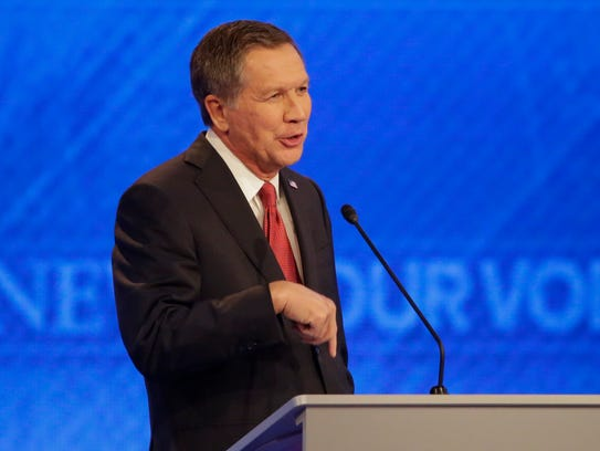 John Kasich makes a point during the Republican primary