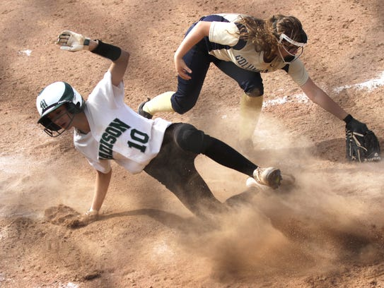 Madison's Leah Boggs scores a run while sliding into