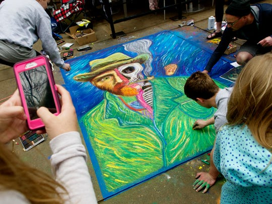 People admire artwork at the Chalk Walk on Market Square