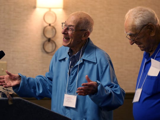 World War II veteran Dick Lacey, left, the current president of the 30th Infantry Division Association, greets the attendees of their reunion on Friday. Standing with him is World War II veteran Frank Towers, the organization's secretary treasurer.