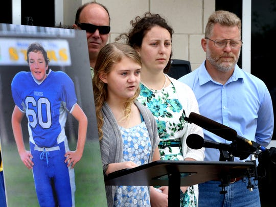 Louann Braunwalder, 13, speaks about her brother Clifton Braunwalder who was hit and killed by an alleged impared driver a year ago today, Friday April 10, 2015, as she stands next to a photograph of her brother Clifton Braunwalder. In honor of Clifton Braunwalder the Rutherford County Sheriff's department is holding a sobriety checkpoint today. Standing behing Louann Braunwalder are family members an uncle, Bobby Stilwell, a sister Nicole Braunwalder, and father Norbert Braunwalder.
