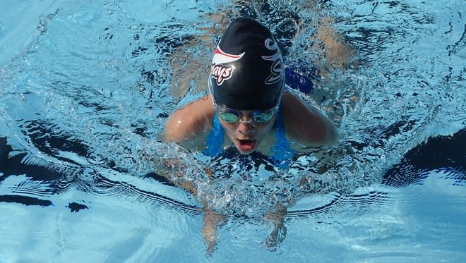 Lillian Rees, 12, swims the 50 breaststroke for the Stingrays on Saturday during the Tri-County Aquatic League season opener against the Pataskala Porpoises at Heath City Water Park.