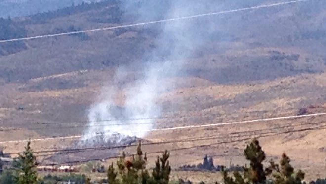 Firefighters were on the scene Monday of a brush fire near Schellbourne Road, just southwest of Reno.
