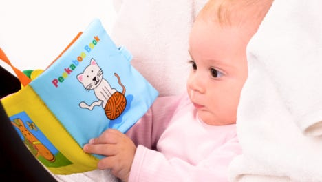 Baby with a book
