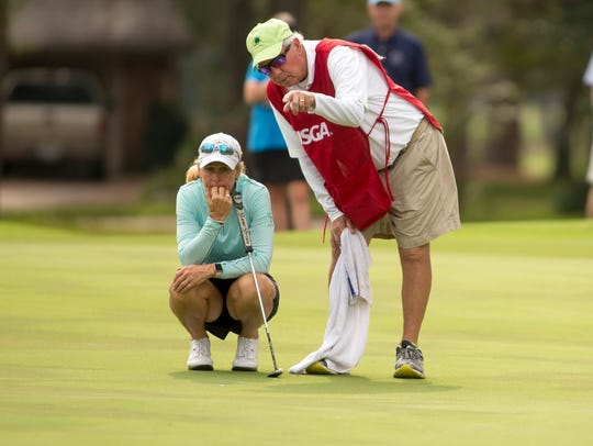Mary Jane Hiestand listens to her caddie and husband Jeff as she prepares to putt on the sixth green during the final round at the 2017 U.S. Women's Mid-Amateur at Champions Golf Club in Houston, Texas. Hiestand, a Hideout Golf Club member, will be playing in the Florida Women's Senior Open at Quail Creek beginning Friday. (Copyright USGA/Darren Carroll)