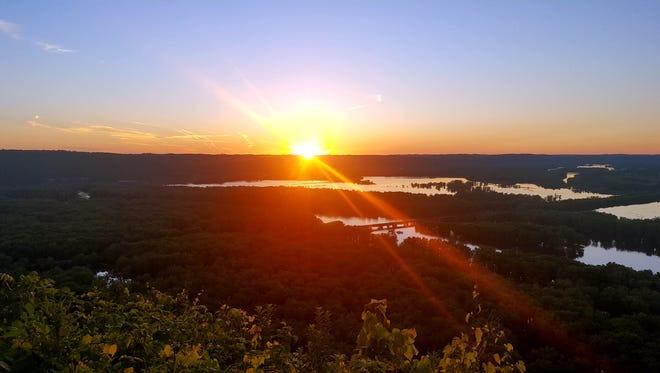 The sun sets over the confluence of the Wisconsin and Mississippi rivers as viewed from Wyalusing State Park.