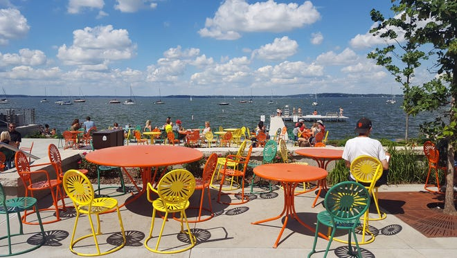 Colorful sunburst chairs and tables are a hallmark of the University of Wisconsin-Madison's Memorial Union Terrace on Lake Mendota.