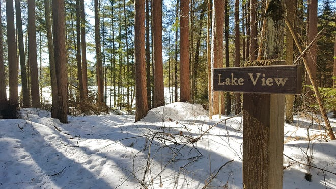 Skiers can take in views of Helen Lake along the McNaughton Lake trails in the Northern Highland American Legion State Forest.