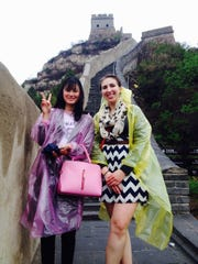 Alyssa Bloechl, right, meets a fellow tourist at the Great Wall.