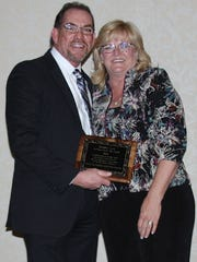 Debbie Lee is presented with the 2016 Affiliate of the Year Award by last year's recipient, Mark Richardson.