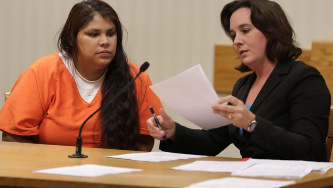 Keshia Waupoose, with attorney Susan Halloway, right, makes an initial appearance in Outagamie County court on Friday, November 18, 2016, in Appleton, Wis.  She is accused in her baby's co-sleeping death and has been held on a charge of second-degree reckless homicide.