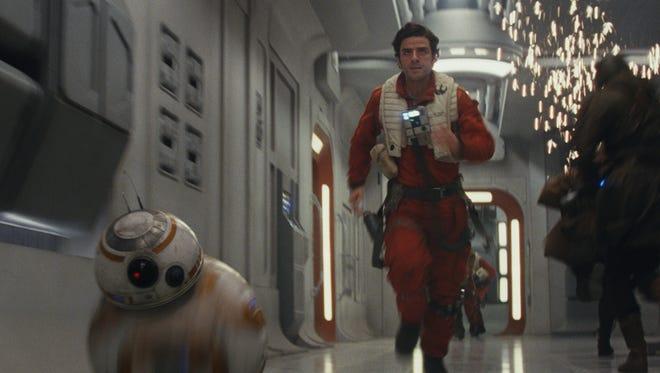 "BB-8 and Poe Dameron (Oscar Isaac) in ""Star Wars: The Last Jedi."""