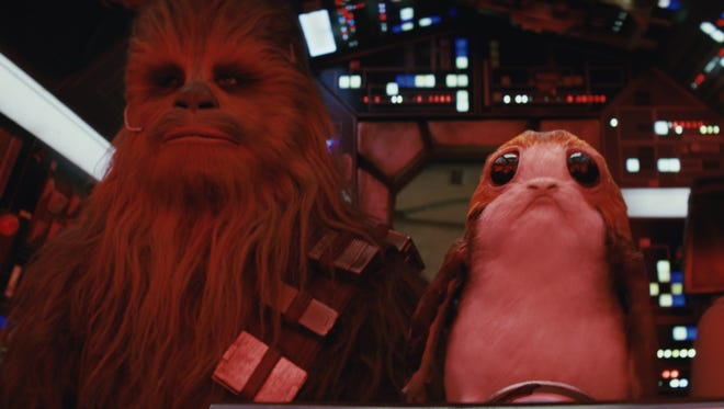 """Chewbacca and a Porg in the Millennium Falcon in a scene from the upcoming """"Star Wars: The Last Jedi."""""""