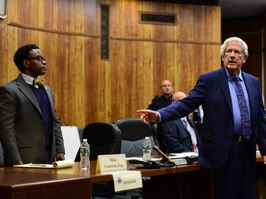 Darien Allen, left, former chairman of the Housing Authority of the city of Passaic, stands Tuesday as his attorney, Miles Feinstein, points to him during the opening statements to the jury.