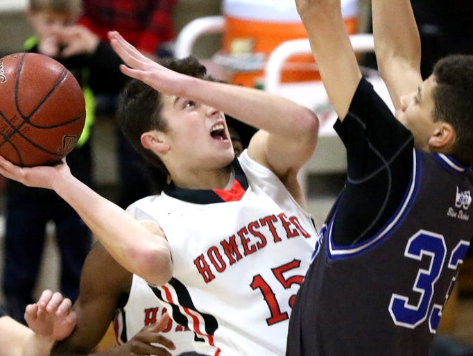 Homestead's Ryan Waddell fires past Whitefish Bay's