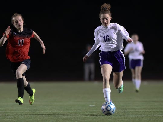 Shasta's Gabrielle Johnson moves the downfield  Tuesday