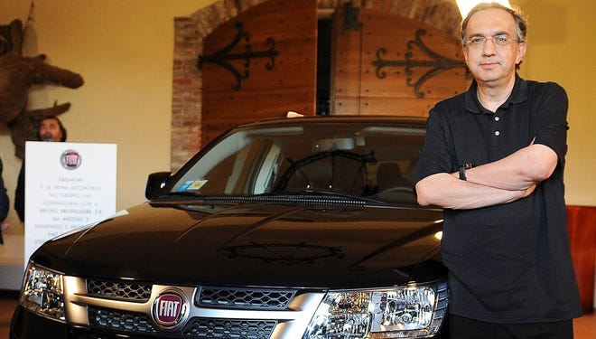 Fiat/Chrysler CEO Sergio Marchionne shows off a Fiat Freemont, which is a variant of the Dodge Journey SUV built at a Chrysler plant in Mexico for the Italian market.
