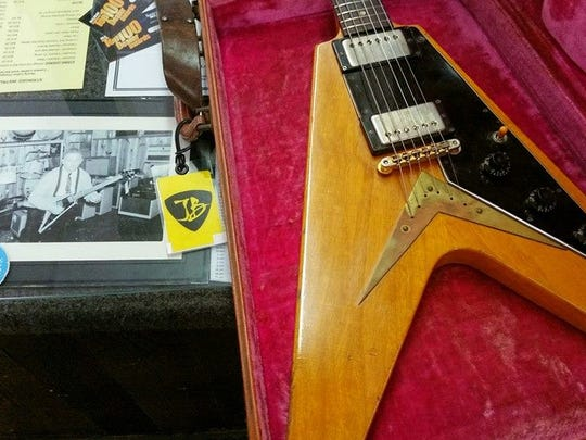 The 1958 Flying V landed back on the counter at Arthur's Music Store last month along with a photo of store founder Amos Arthur playing the guitar in 1958.