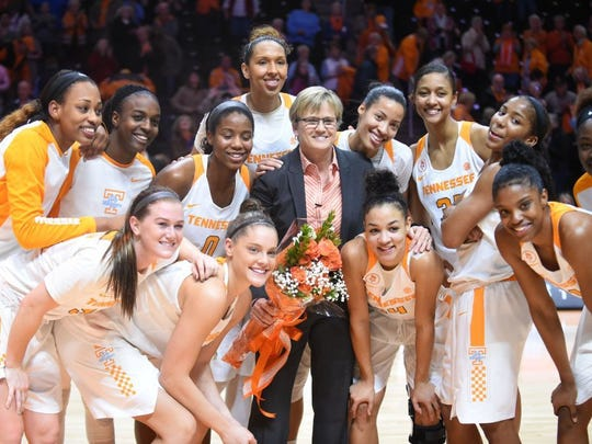 Tennessee head coach Holly Warlick celebrates her 100th career win after the Lady Vols defeated the Razorbacks 75-57 at Thompson-Boling Arena on Thursday, Feb. 4, 2016. (CAITIE MCMEKIN/NEWS SENTINEL)